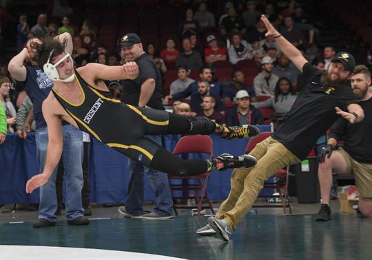 Crescent senior C.C. Spires, left, drop kicks his coach Austin Powell after beating May River's Roderick Grant in the 195-pound weight class of the Class 3A state championship at the Civic Center of Anderson Saturday, February 23, 2019.