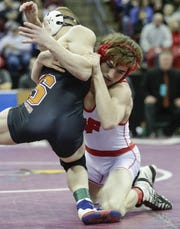 Weyauwega-Fremont's Cian Fischer wrestles Stratford's Manny Drexler in the Division 3 120-pound championship match Saturday during the WIAA state individual wrestling tournament at the Kohl Center in Madison.