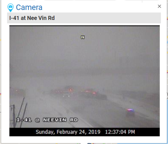 A Wisconsin Department of Transportation highway camera shows emergency vehicles on Interstate 41 southbound near Neenah. Upward of 100 vehicles were involved in a pileup in the northbound lanes.