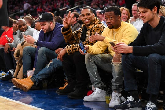 Victor Cruz watches the game between the St. John's Red Storm and the Seton Hall Pirates during the second half at Madison Square Garden.