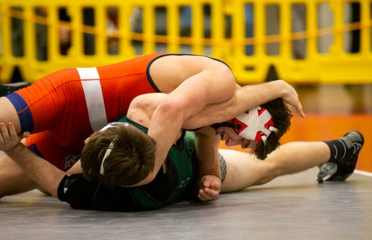 Wall's Robert Kanniard pins Raritan's Anthony Aquilano to win the Region VI 160-pound championship Saturday