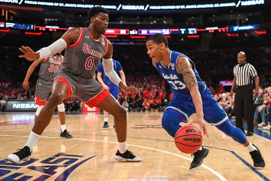 Seton Hall Pirates guard Shavar Reynolds (33) drives to the basket on St. John's Red Storm forward Sedee Keita (0) during the first half at Madison Square Garden.