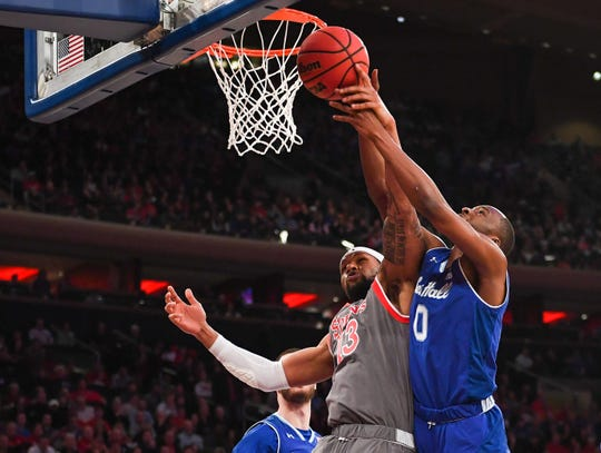 St. John's Red Storm forward Marvin Clark II (13) blocks the shot of Seton Hall Pirates guard Quincy McKnight (0) during the first half at Madison Square Garden.