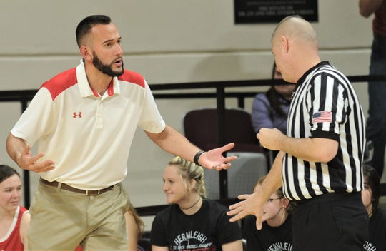 Hermleigh coach Duane Hopper, left, argues a call with an official during the Lady Cardinals' game against Rankin. Hermleigh beat the Lady Devils 58-46 in the Region II-1A championship game Saturday, Feb. 23, 2019, at ACU's Moody Coliseum.