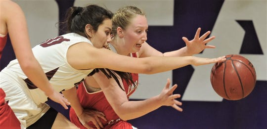 Hermleigh's Lillyan Digby, right, battles Rankin's Jenni Renteria for a loose ball. Hermleigh beat the Lady Devils 58-46 in the Region II-1A championship game Saturday, Feb. 23, 2019, at ACU's Moody Coliseum.