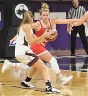 Hermleigh's Lynzie Stewart, right, defends against a Rankin player in the first half. Hermleigh beat the Lady Devils 58-46 in the Region II-1A championship game Saturday, Feb. 23, 2019, at ACU's Moody Coliseum.