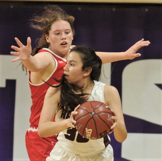 Hermleigh's Makia Gonzales, left, pressures Rankin's Jenni Renteria. Hermleigh won the Region II-1A championship game 58-46 on Saturday, Feb. 23, 2019, at ACU's Moody Coliseum.