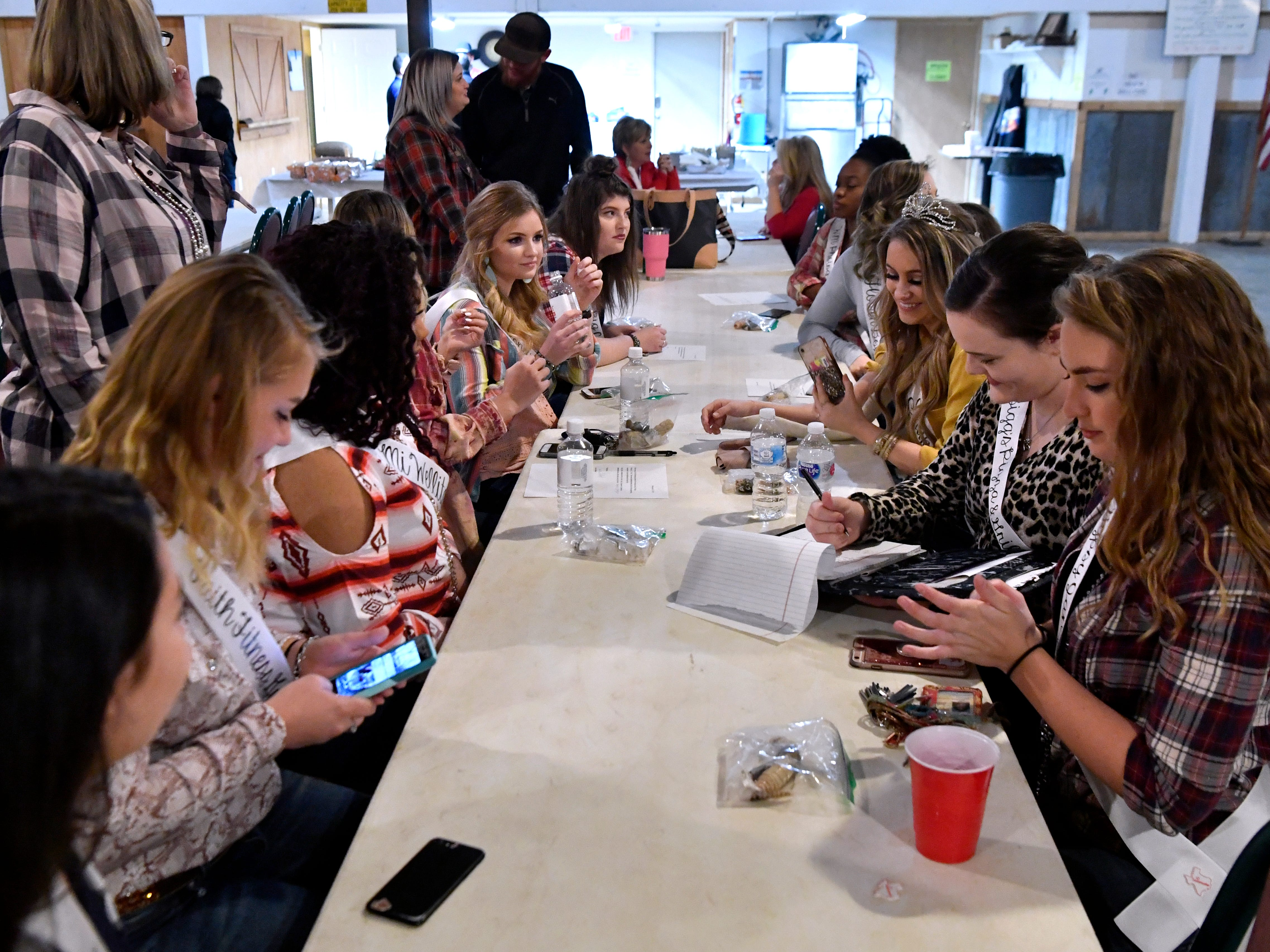 Miss Snake Charmer contestants wait for lunch to be served Friday Feb. 22, 2019 at the Sweetwater Jaycee's Barn. Media Day introduces the Big Country to this year's Miss Snake Charmer contestants. The pageant will be March 7, followed by the World's Largest Rattlesnake Roundup March 8-10.