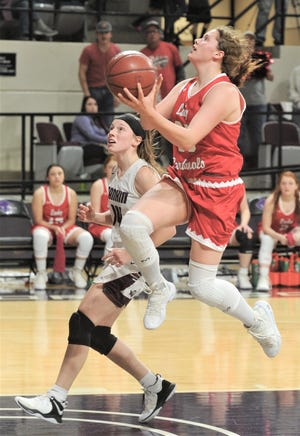 Hermleigh's Makia Gonzales, right, drives to the basket as Rankin's Michaela Jackson defends in the second half. Hermleigh beat the Lady Devils 58-46 in the Region II-1A championship game Saturday, Feb. 23, 2019, at ACU's Moody Coliseum.