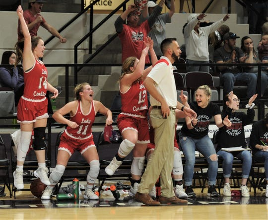 Hermleigh's Ciera Digby, left, Lynzie Stewart (11) and Sandra Carr (12) celebrate as the clock hits zero in the Lady Cardinals' 58-46 victory over Rankin in the Region II-1A girls basketball finals on Saturday, Feb. 23, 2019, at ACU's Moody Coliseum.