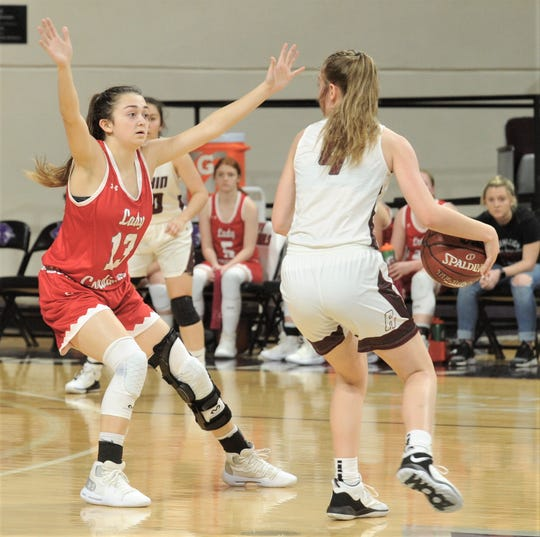 Hermleigh's Ryleigh Benitez, left, defends against Rankin in the Region II-1A championship game 58-46 on Saturday at ACU's Moody Coliseum.