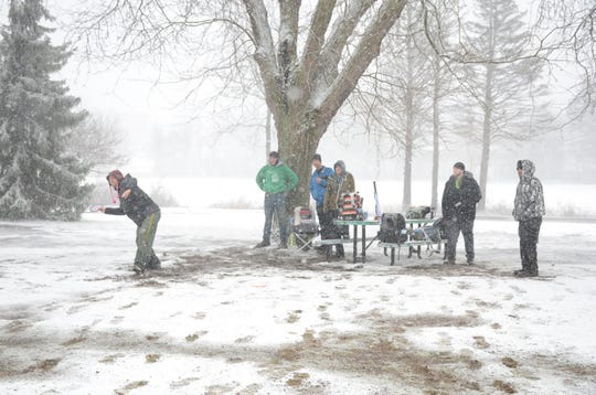 Kevin Baldwin, 43, lets his disc fly at the Irving Park Disc golf Course on Sunday.Cold, Snow and High Winds didn't deter a regular group who play each Sunday morning.