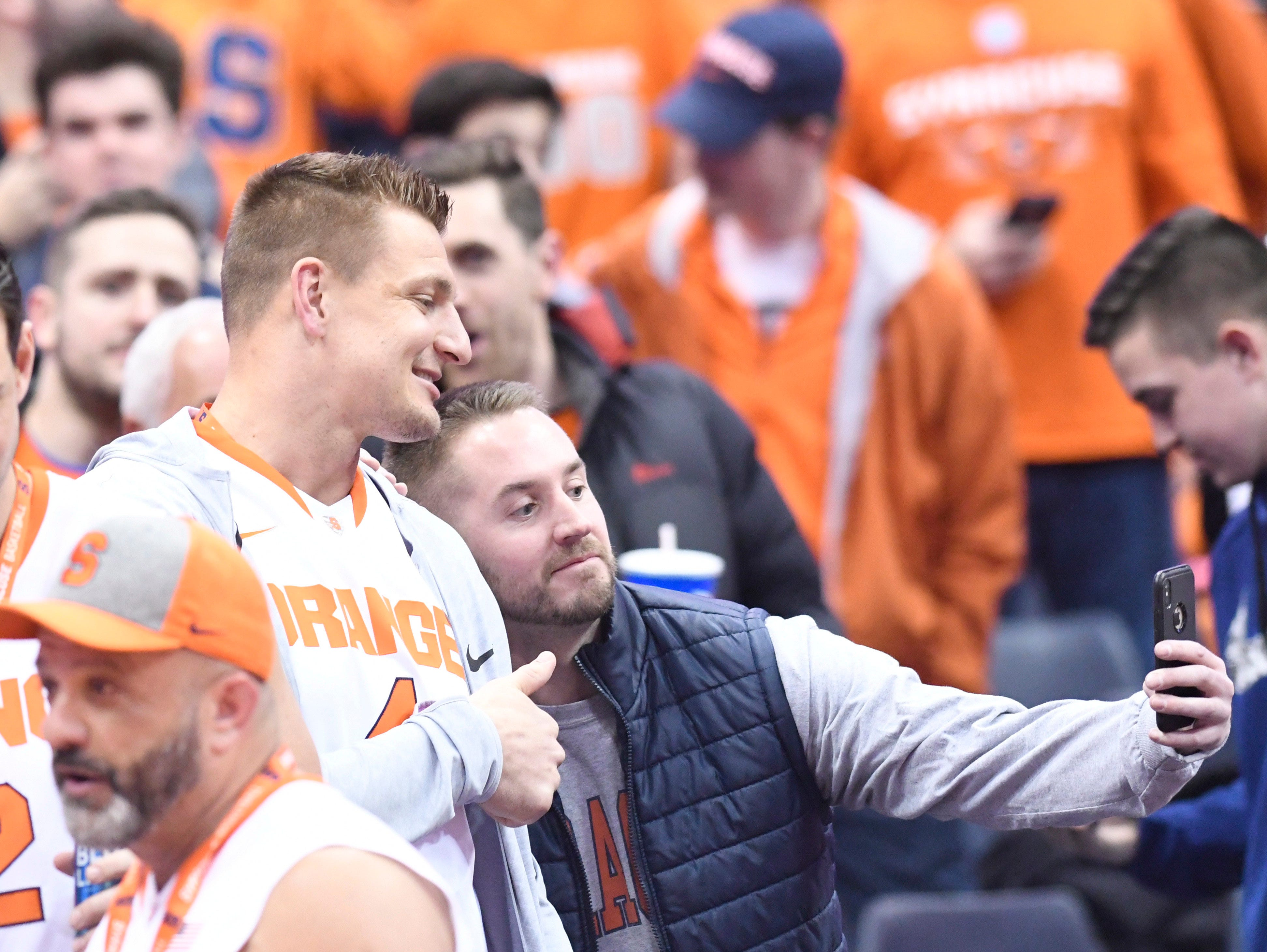 Feb 23, 2019; Syracuse, NY, USA; New England patriot Rob Gronkowski poses with a fan for a selfie prior to a game between the Syracuse Orange and the Duke Blue Devils at the Carrier Dome. Mandatory Credit: Mark Konezny-USA TODAY Sports
