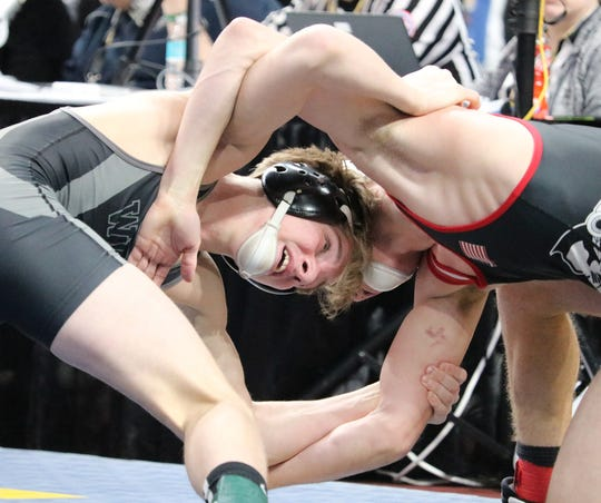 Chandler Merwin of Walton/Delhi, left, doing work in the 126-pound final Saturday in Albany.