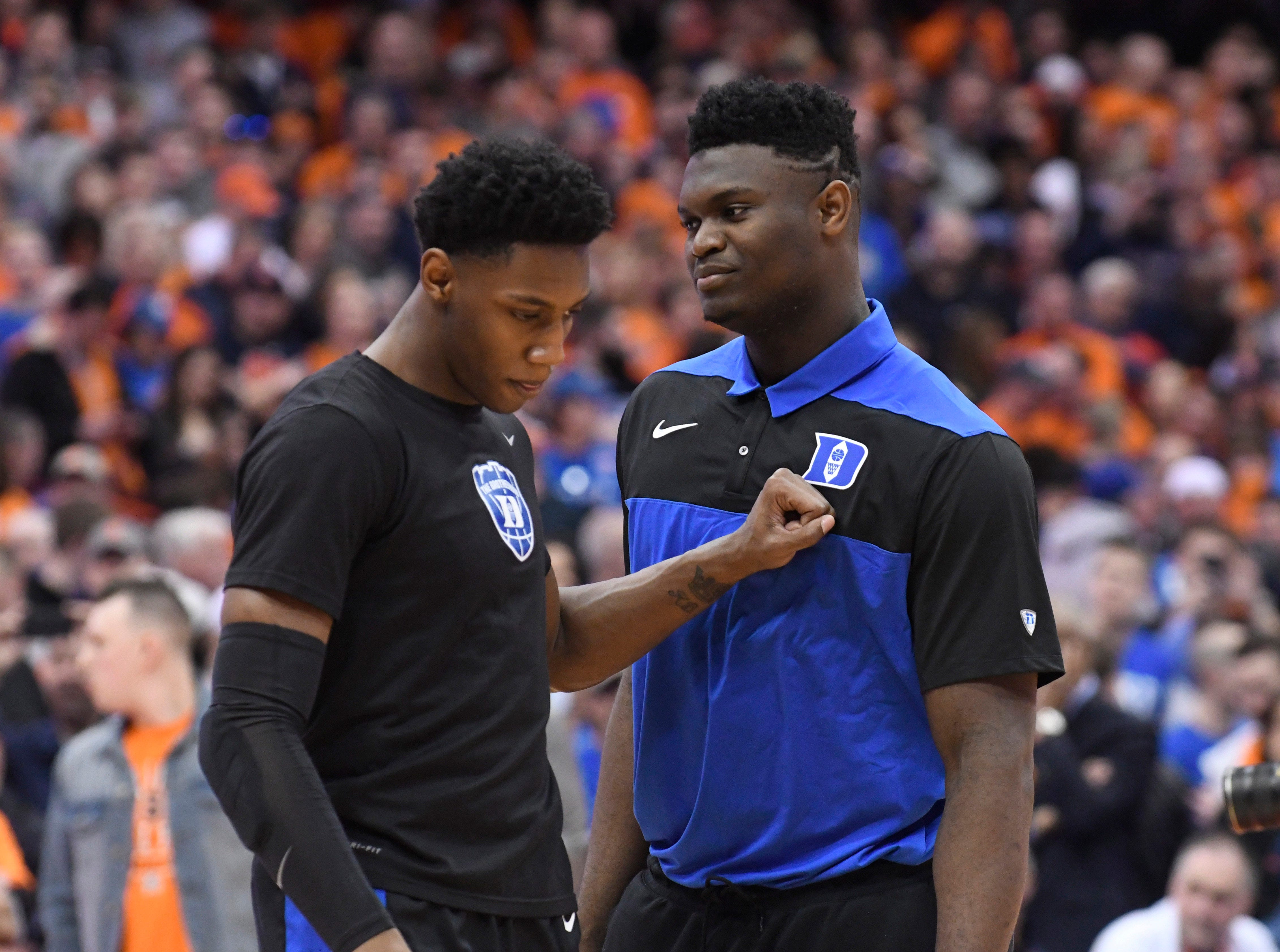 Feb 23, 2019; Syracuse, NY, USA; Duke Blue Devils forward RJ Barrett (5) taps the chest of teammate Zion Williamson prior to a game against the Syracuse Orange at the Carrier Dome. Mandatory Credit: Mark Konezny-USA TODAY Sports