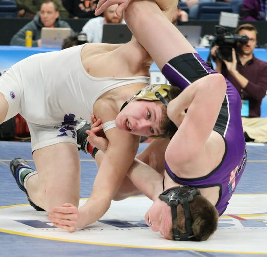 Mikey Squires of Norwich, right, competing in the 152-pound final.