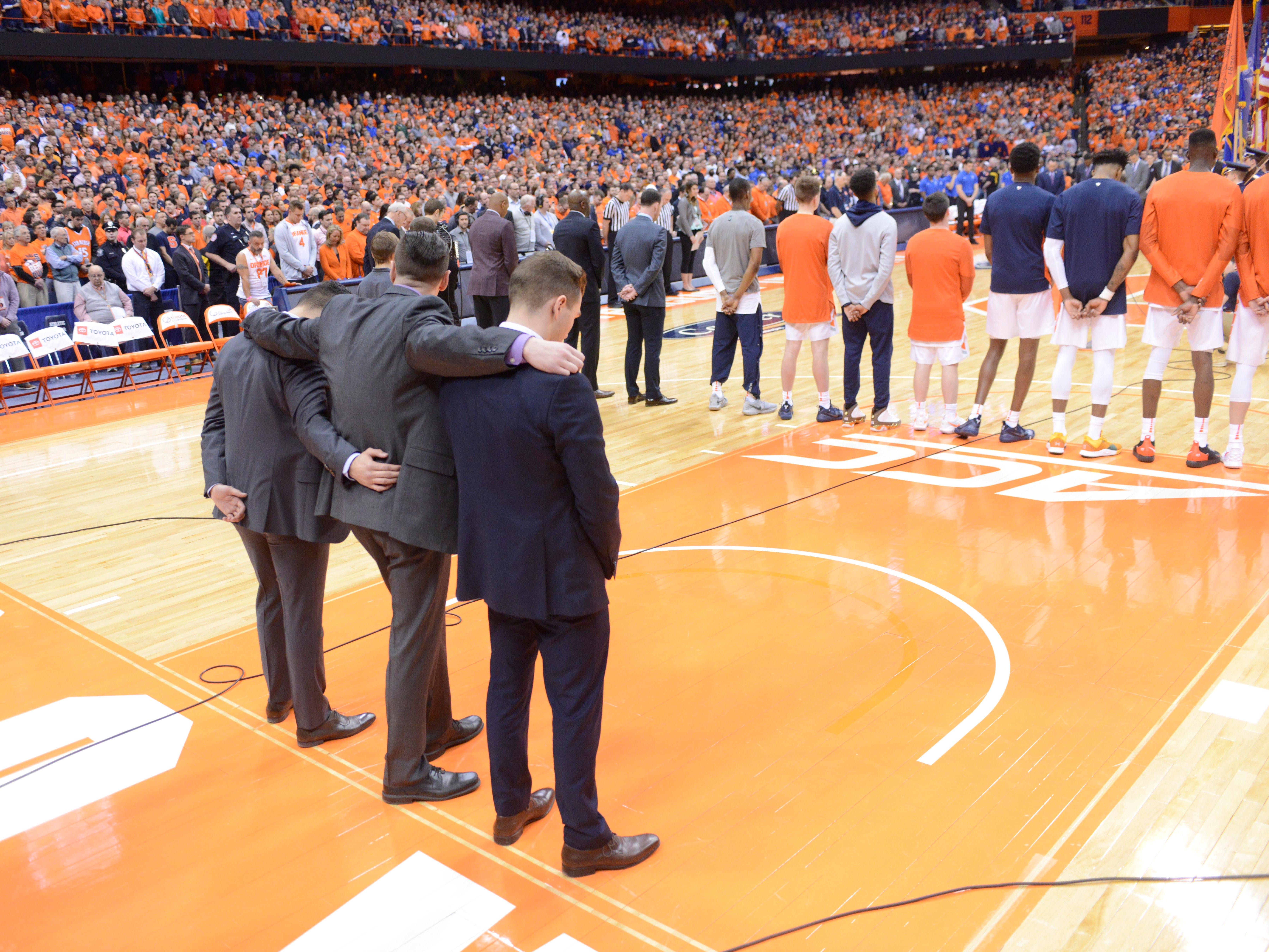 Feb 23, 2019; Syracuse, NY, USA; The Syracuse Orange team, fans and Duke Blue Devils pause for a moment of silence prior to a game at the Carrier Dome to remember Jorge Jimenez who died when accident struck by Syracuse Orange head coach Jim Boeheim's car last Wednesday night. Mandatory Credit: Mark Konezny-USA TODAY Sports