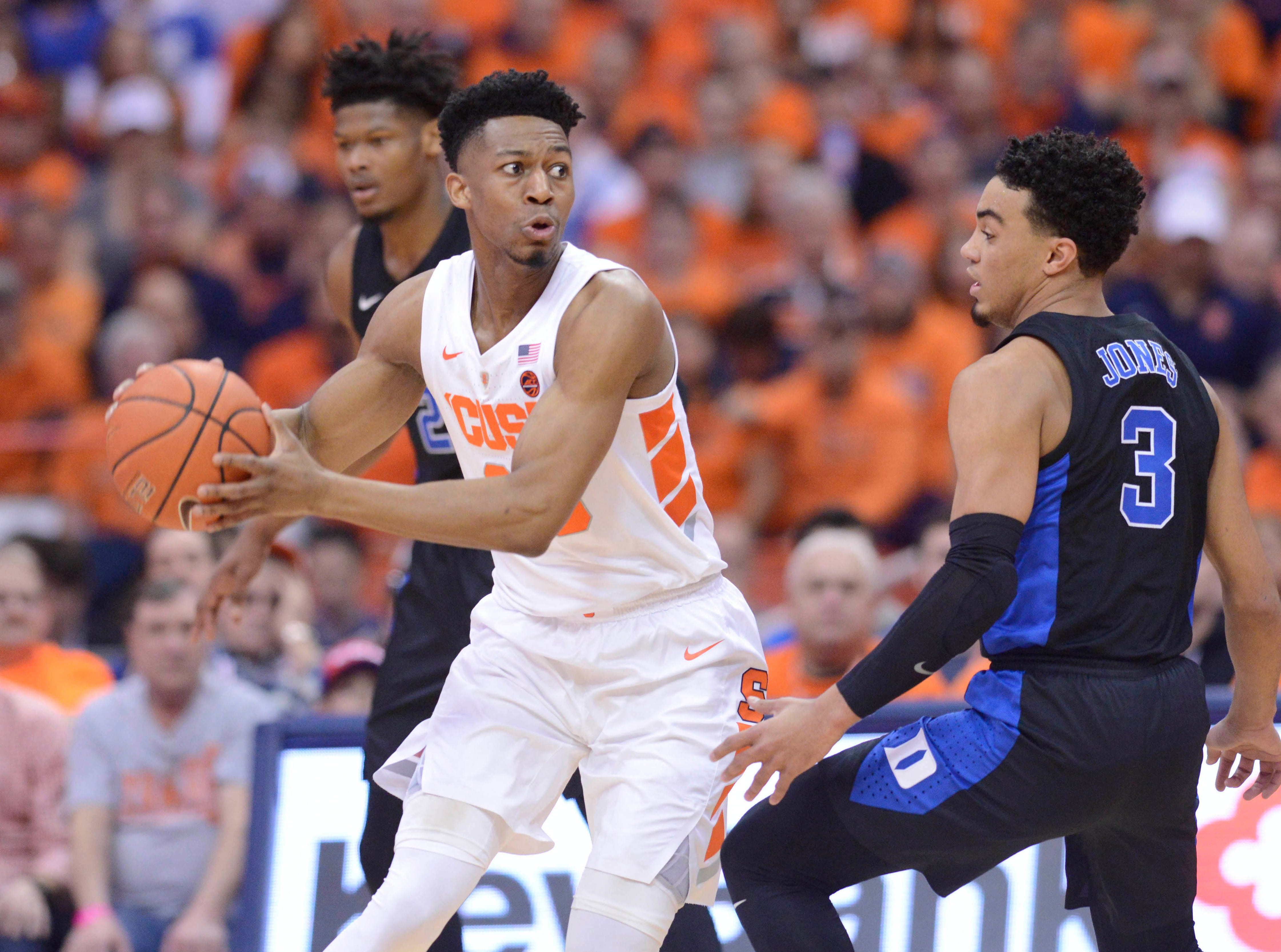 Feb 23, 2019; Syracuse, NY, USA; Syracuse Orange guard Tyus Battle looks to make a pass as Duke Blue Devils guard Tre Jones (3) defends in the first half at the Carrier Dome. Mandatory Credit: Mark Konezny-USA TODAY Sports