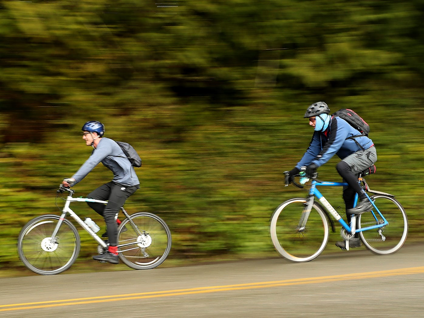 Cyclists speed around the corner of Arrow Point Drive NW during Cascade Bicycle Club's annual Chilly Hilly ride around Bainbridge Island on Sunday, February 24, 2019.