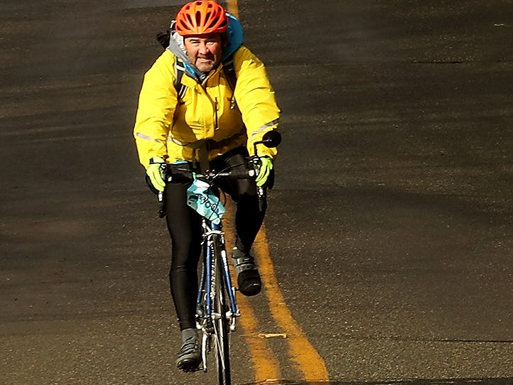 A cyclists zooms down Battle Point Drive NE during Cascade Bicycle Club's annual Chilly Hilly ride around Bainbridge Island on Sunday, February 24, 2019.