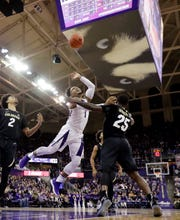 Washington guard David Crisp (1) collides with Colorado guard McKinley Wright IV (25) during the first half of an NCAA college basketball game Saturday, Feb. 23, 2019, in Seattle. (AP Photo/Ted S. Warren)