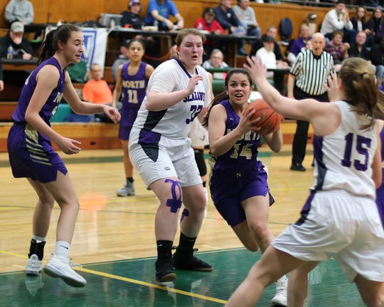 North Kitsap's Noey Barreith drives the lane during the Vikings' regional game Saturday against Anacortes at Mount Vernon High School. Anacortes won 64-49 to end North Kitsap's season.