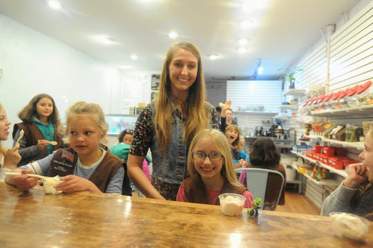 Paislee Cordell, who has sold 4,000 boxes of Girl Scout cookies since early January, and her mom Jody were among those in The Hop Ice Cream on Cherry Street on Feb. 22.