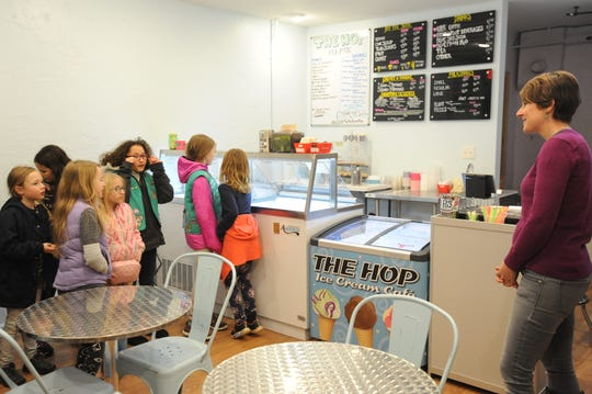 Ashley Garrison, owner of The Hope Ice Cream on Cherry Street, welcomes Black Mountain Girl Scouts Troop 02498 into her business on Feb. 22.