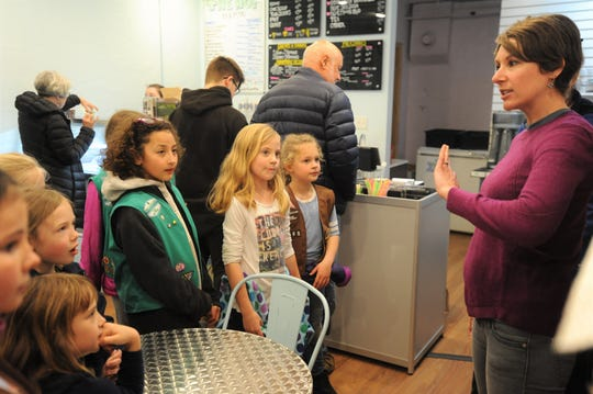 The Hop Ice Cream owner Ashley Garrison hosts Black Mountain Girl Scouts for a question and answer session in her business on Feb. 22.