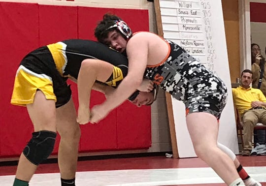 Lucas freshman Zane Finley leans on Monroeville's Daniel Smith en route to a 19-5 major decision for third place at 160 pounds in the Division III sectional wrestling tournament at