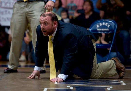 Essex coach Ira Isham watches the action in the 132-pound final at the 2019 Vermont high school wrestling state championships on Saturday at Essex High School.