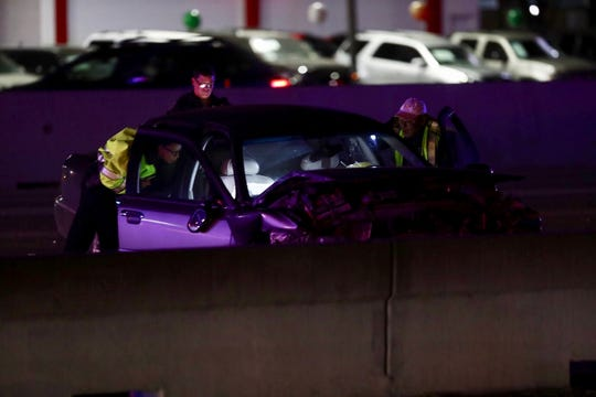 Law enforcement officers work on a car after a major accident on SPID near Everhart and Weber on Saturday, Feb. 23, 2019.