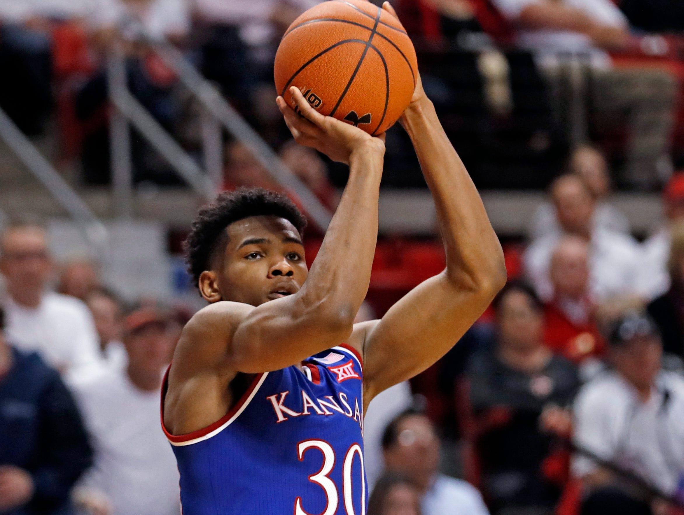 Kansas' Ochai Agbaji (30) shoots during the second half of the team's NCAA college basketball game against Texas Tech, Saturday, Feb. 23, 2019, in Lubbock, Texas. (AP Photo/Brad Tollefson)