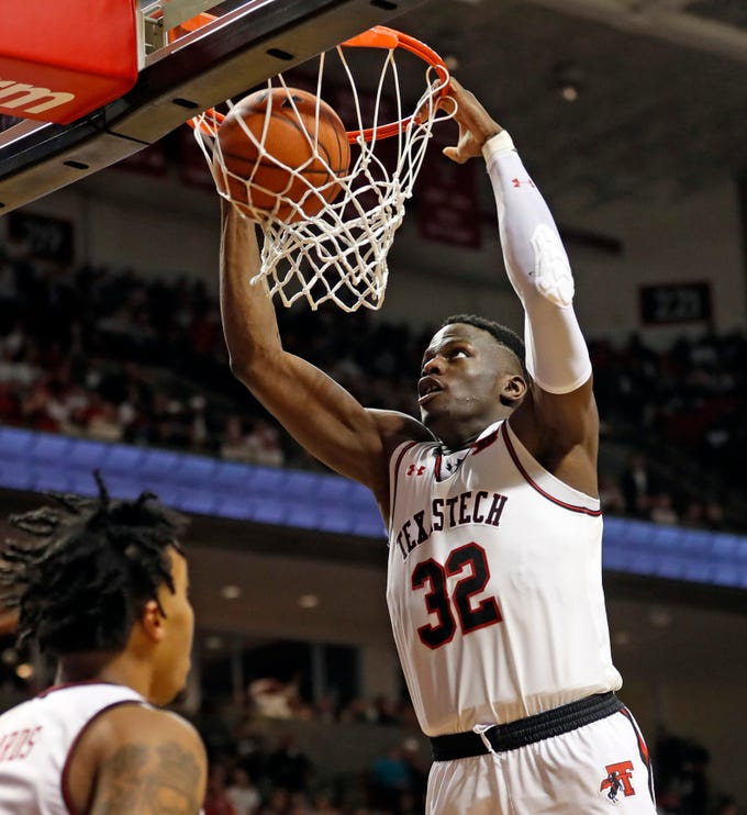 Texas Tech's Norense Odiase (32) dunks during the second half of the team's NCAA college basketball game against Kansas, Saturday, Feb. 23, 2019, in Lubbock, Texas. (AP Photo/Brad Tollefson)