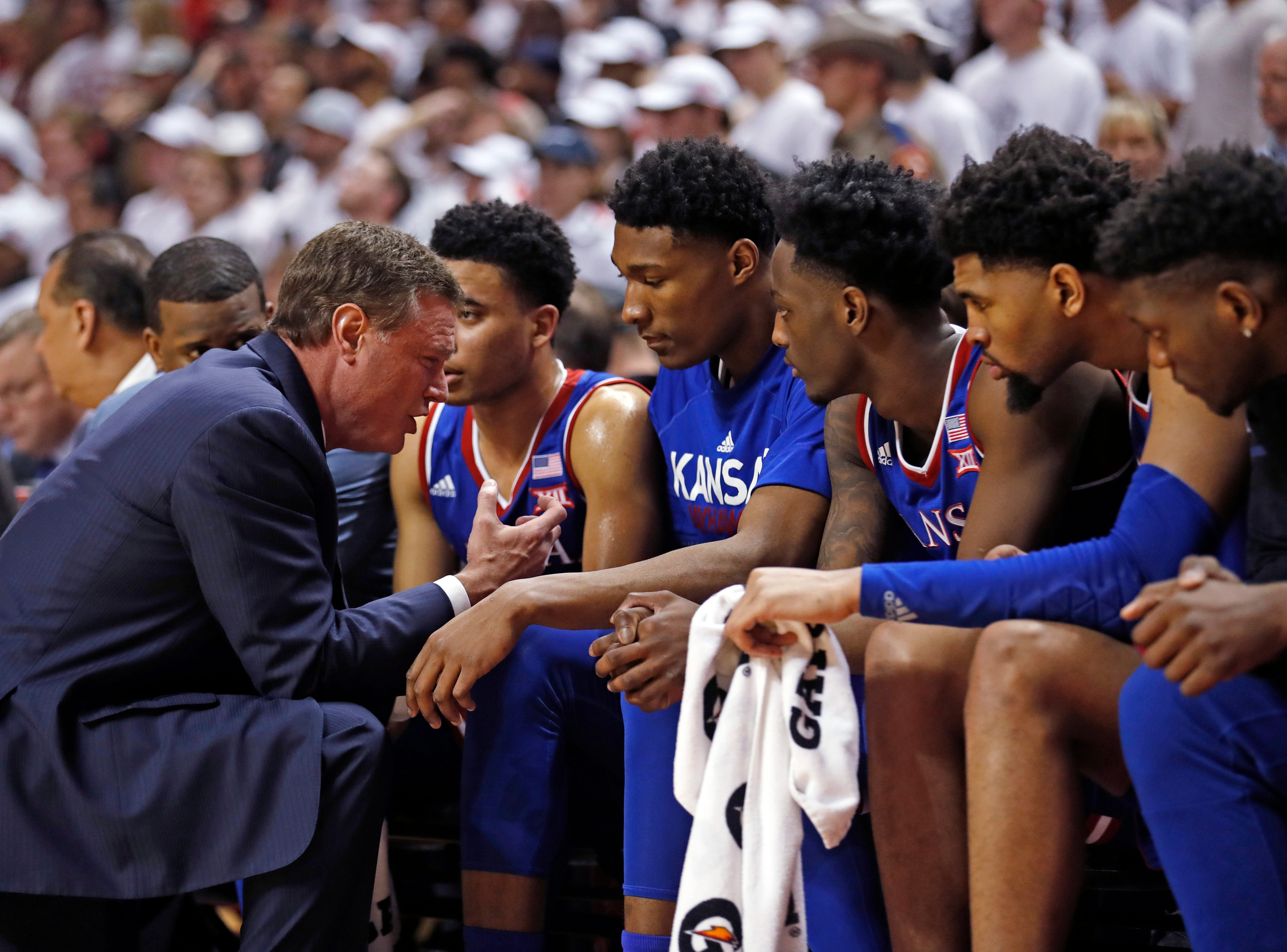 Kansas coach Bill Self talks to his players on the bench during the second half of the team's NCAA college basketball game against Texas Tech, Saturday, Feb. 23, 2019, in Lubbock, Texas. (AP Photo/Brad Tollefson)