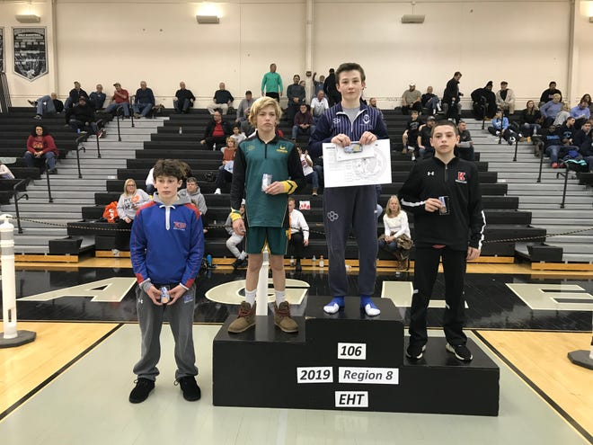 St. Augustine's Ryan DeFoney stands on top of the podium after winning the 106-pound Region 8 title at Egg Harbor Township on Saturday.