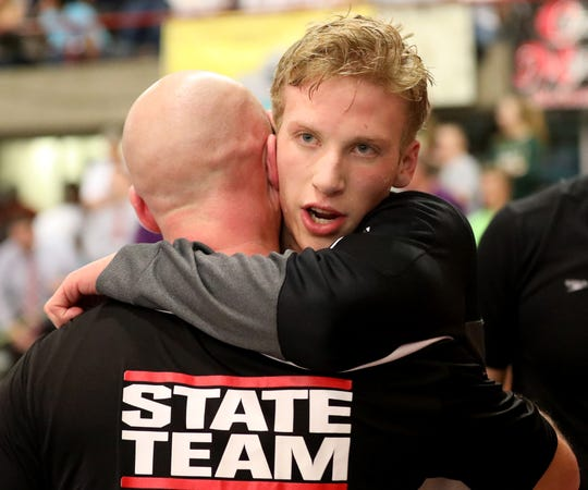 Lakota East swimmer  Jacob McDonald celebrates after winning the boys 500 free at the OHSAA state swimming and diving championships in Canton, Ohio, Friday, Feb. 23, 2019.