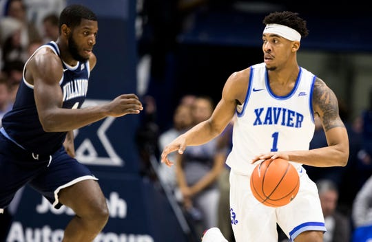 Xavier Musketeers guard Paul Scruggs (1) dribbles down court in the second half of the NCAA men's basketball game between Xavier Musketeers and Villanova Wildcats on Saturday, Feb. 24, 2019, at Cintas Center in Cincinnati. Xavier Musketeers defeated Villanova Wildcats 66-54.