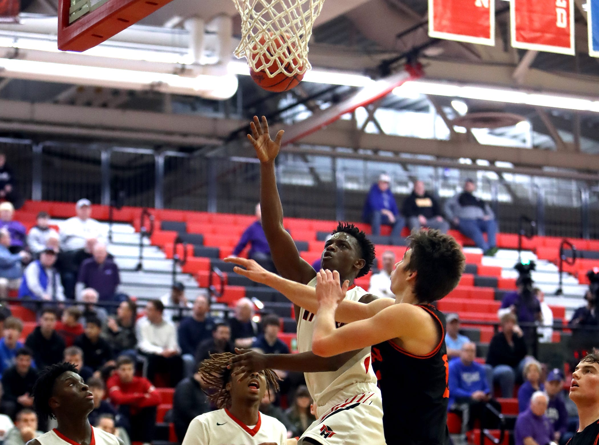 Mount Healthy guard Aushadon Mathis drivers and scores in the sectional playoffs at Lakota West High School Feb. 23, 2019. Mount Healthy defeated Loveland 62-57.