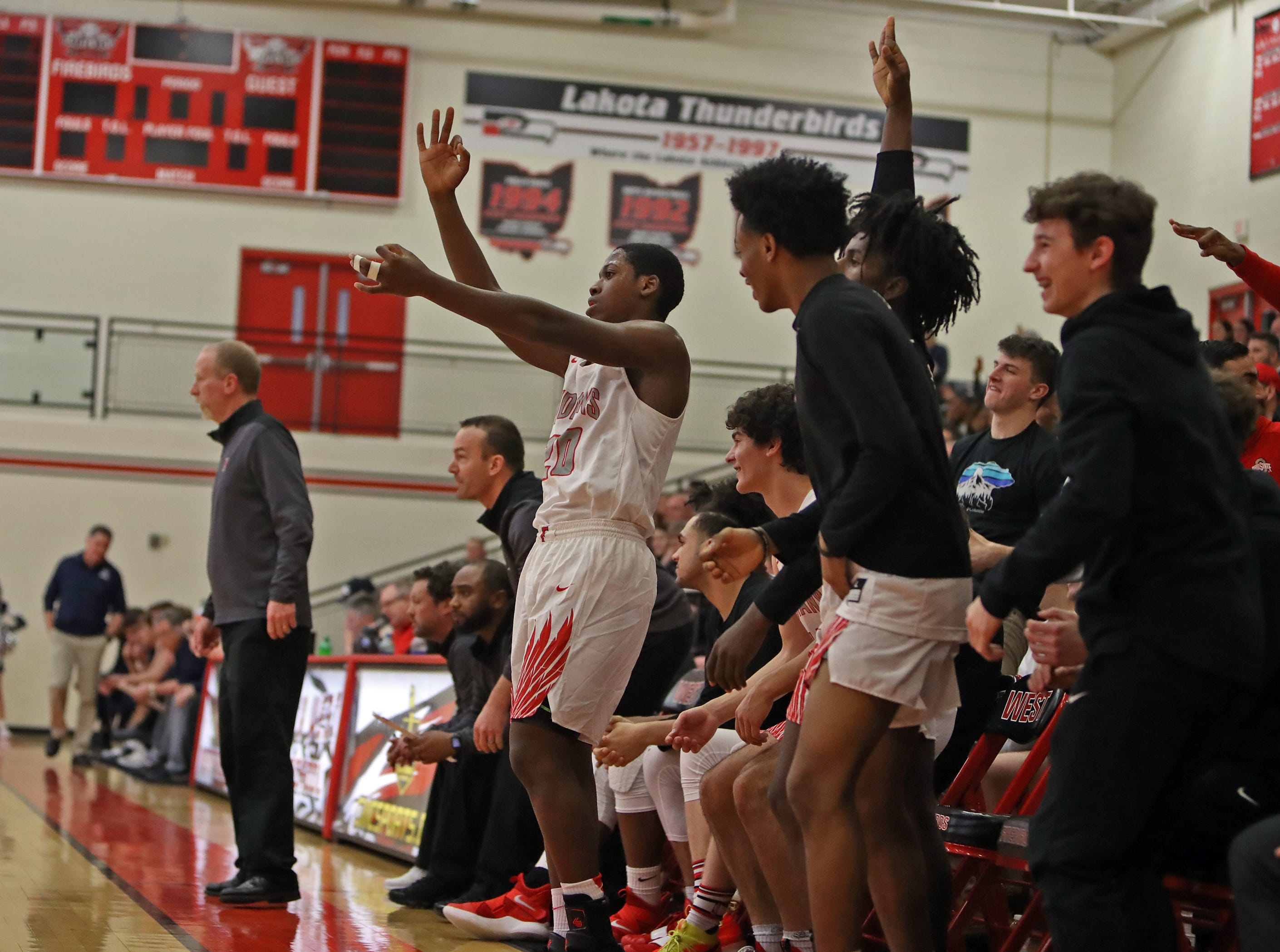 Fairfield's bench erupts after a three-point goal Feb. 23 against West Clermont.