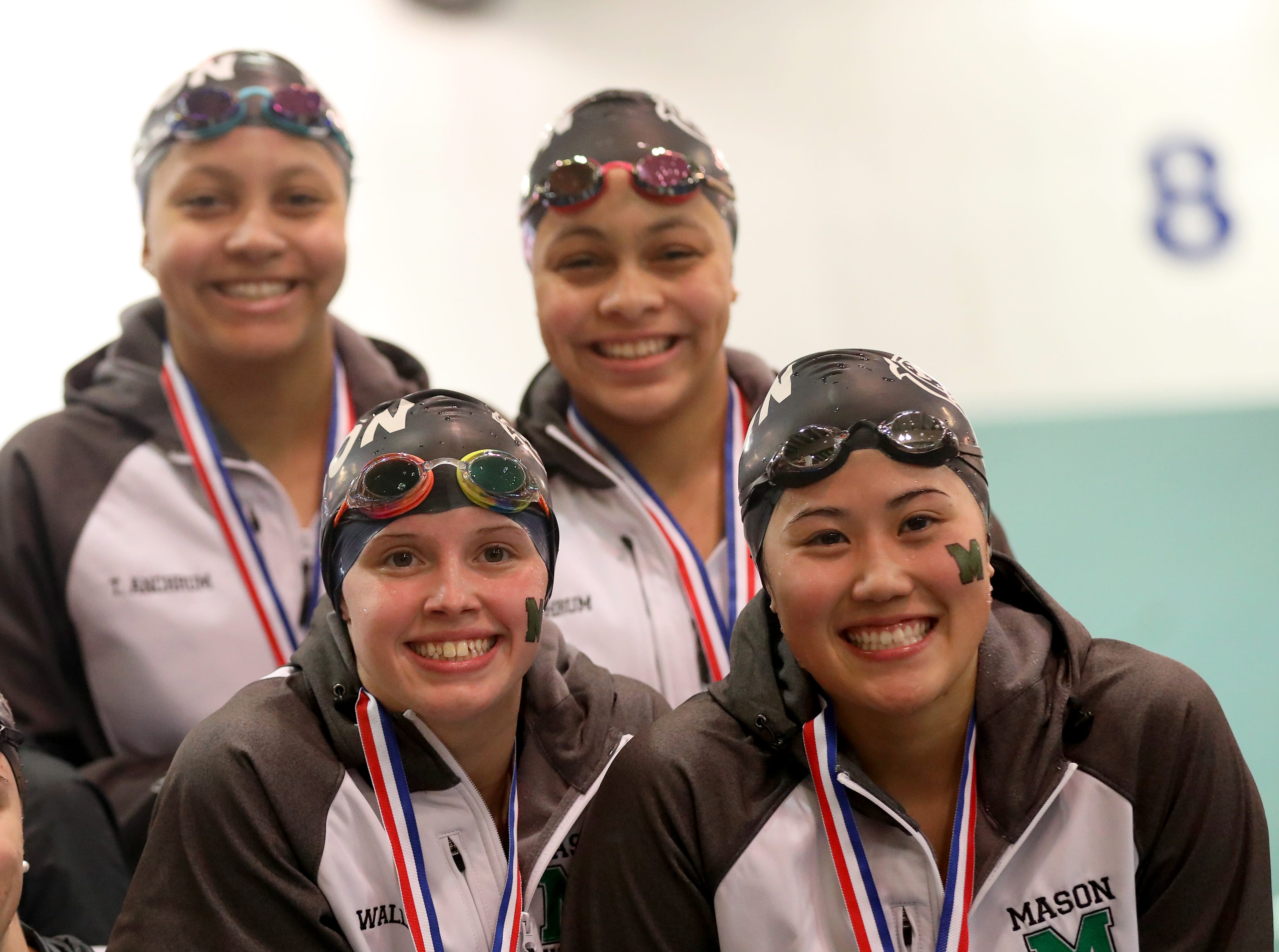 Mason relay team celebrates on the podium after finishing second in the 200 free relay at the OHSAA state swimming and diving championships in Canton, Ohio, Friday, Feb. 23, 2019.