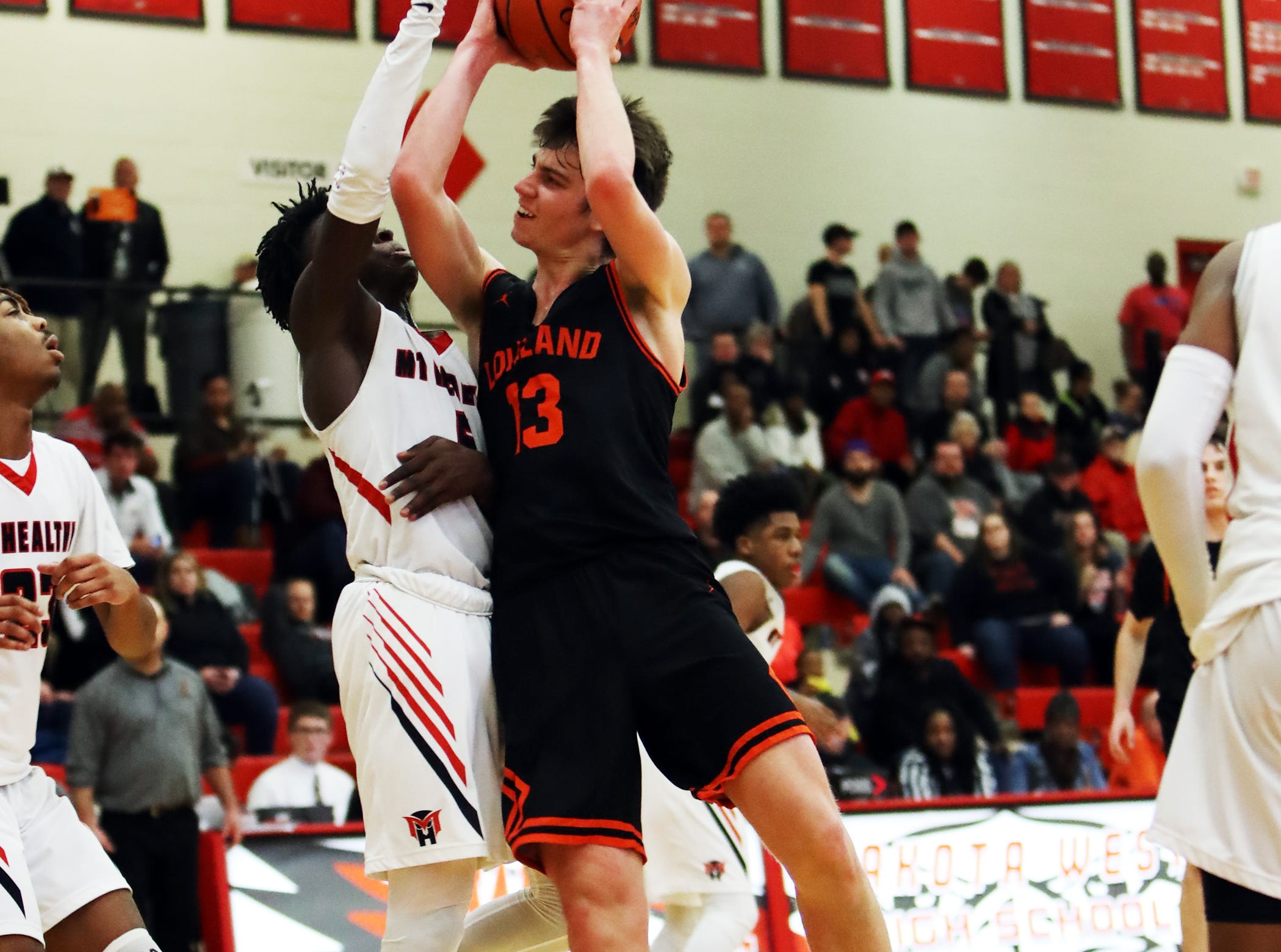 Loveland guard Jalen Greiser drives and scores in the sectional playoffs at Lakota West High School Feb. 23, 2019. Mount Healthy defeated Loveland 62-57.
