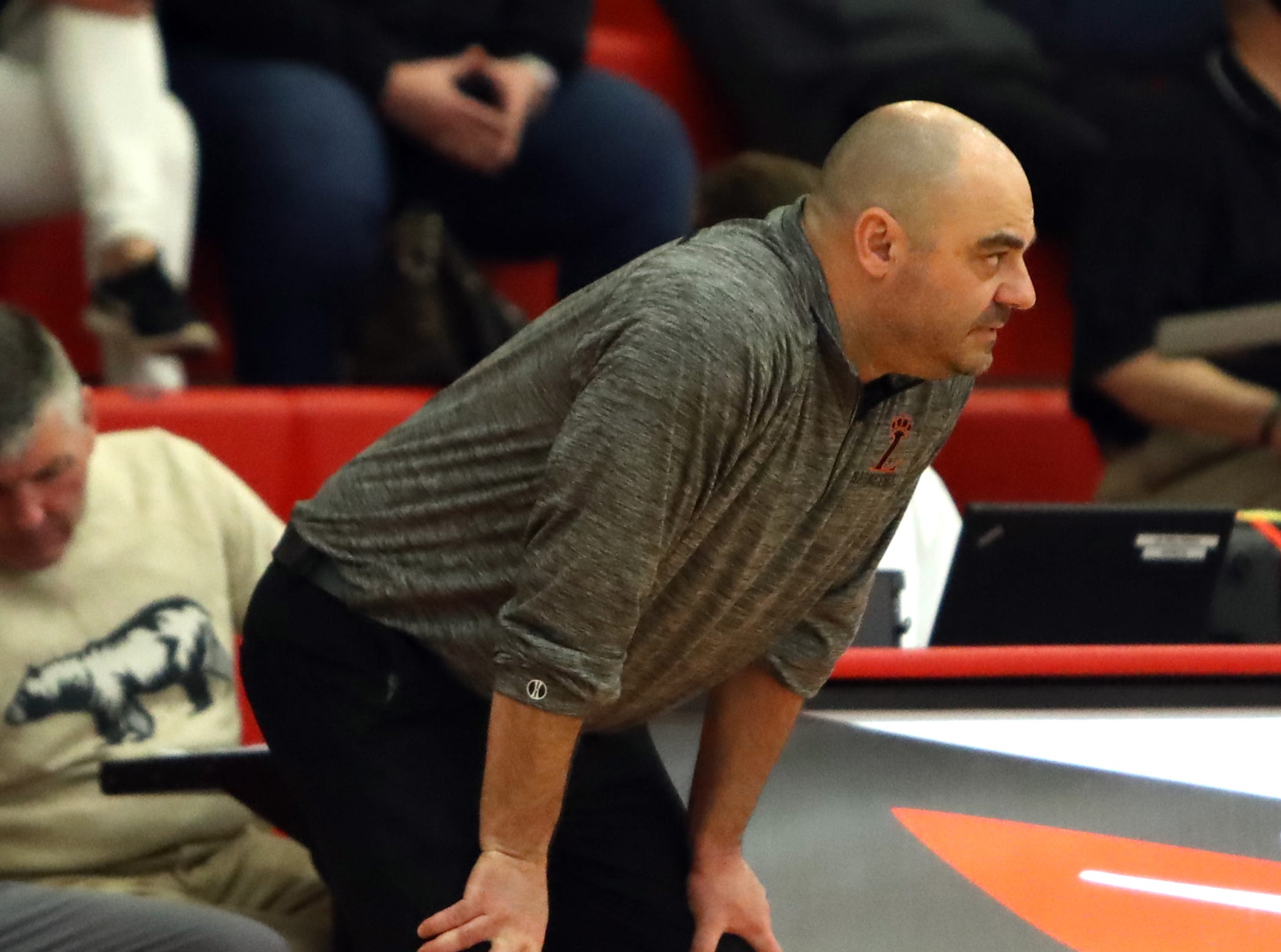 Loveland head coach Rob Reis watches his offense work in the sectional playoffs at Lakota West High School Feb. 23, 2019. Mount Healthy defeated Loveland 62-57.