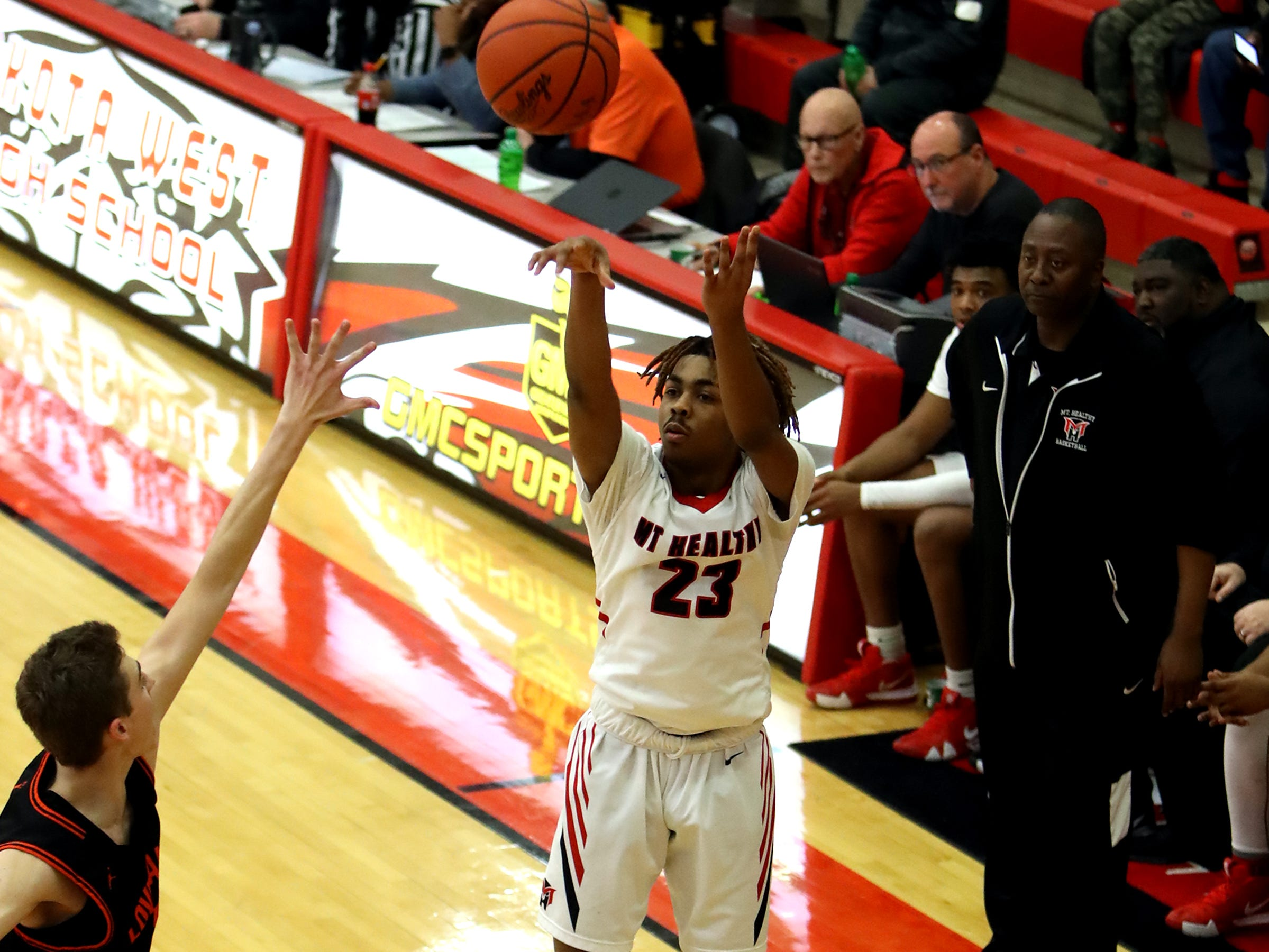 Mount Healthy guard Chris Simmons hits a three-point shot in the sectional playoffs at Lakota West High School Feb. 23, 2019. Mount Healthy defeated Loveland 62-57.