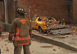 A building near Findlay Market partially collapsed Sunday in the high winds.