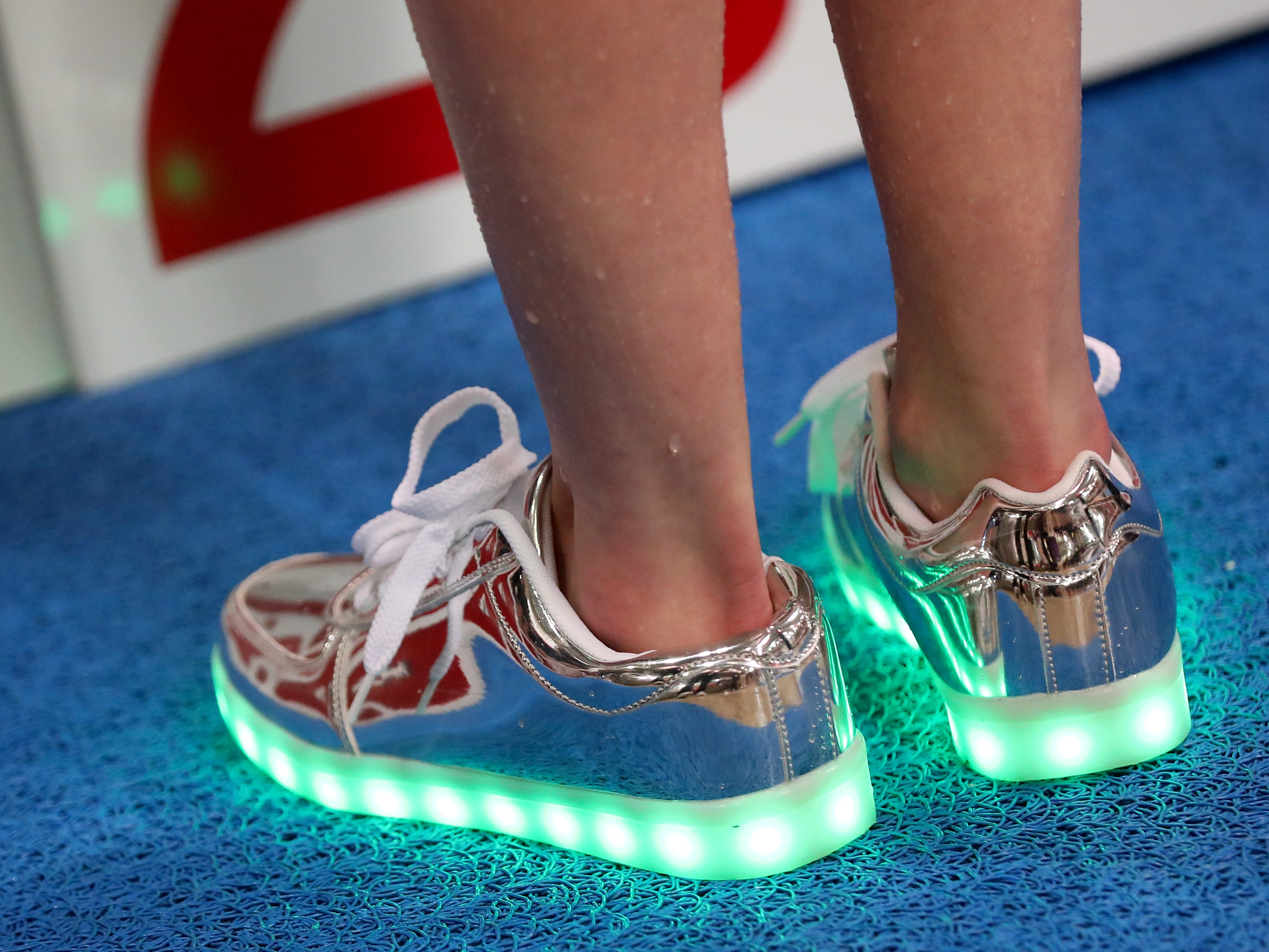 Mason swimmers where wearing these shoes at the OHSAA state swimming and diving championships in Canton Ohio, Friday, Feb. 23, 2019.