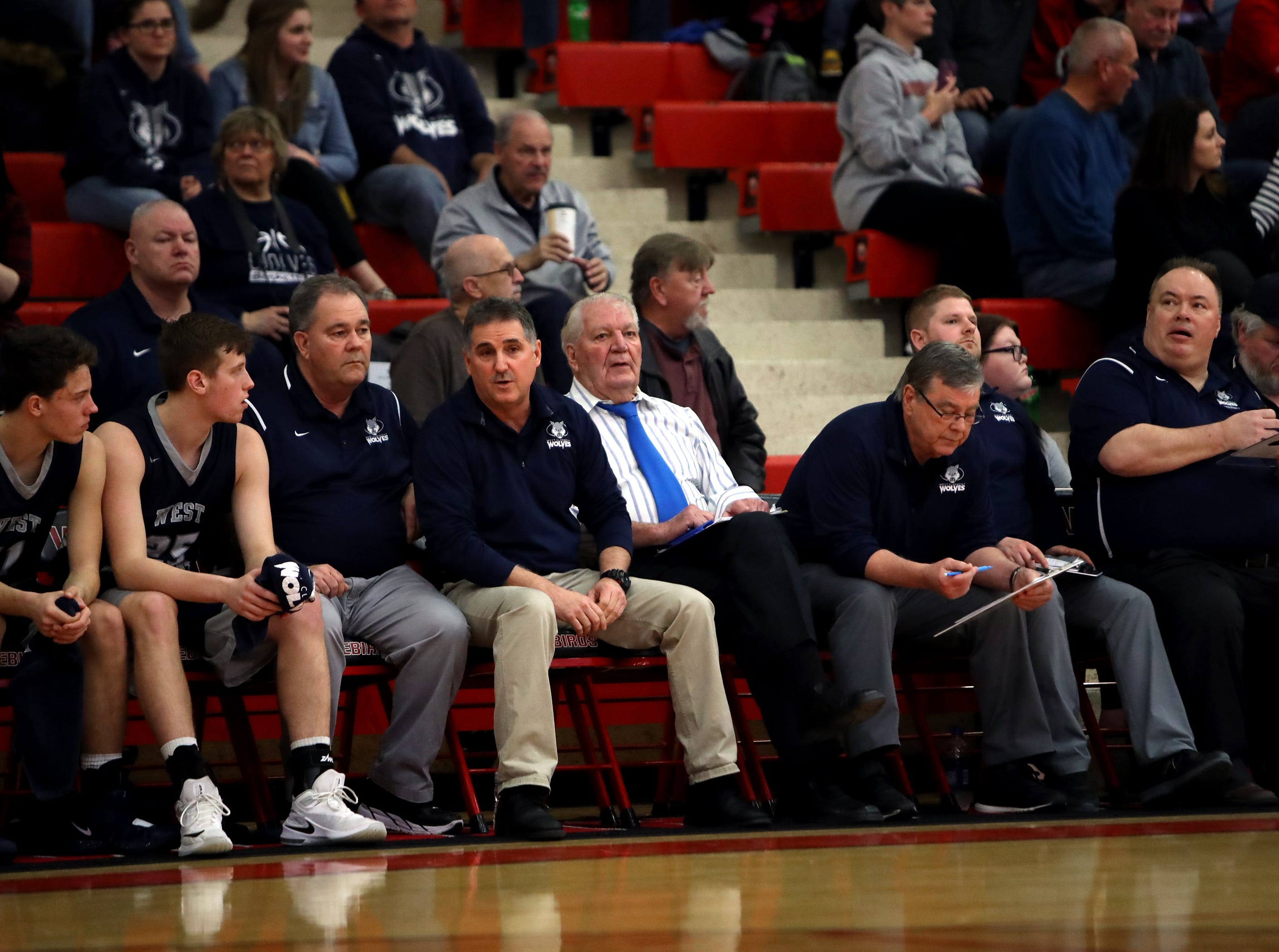 West Clermont head coach Craig Mazzaro, center, and all his assistant coaches just before the start of the Sectional playoff game against Fairfield.