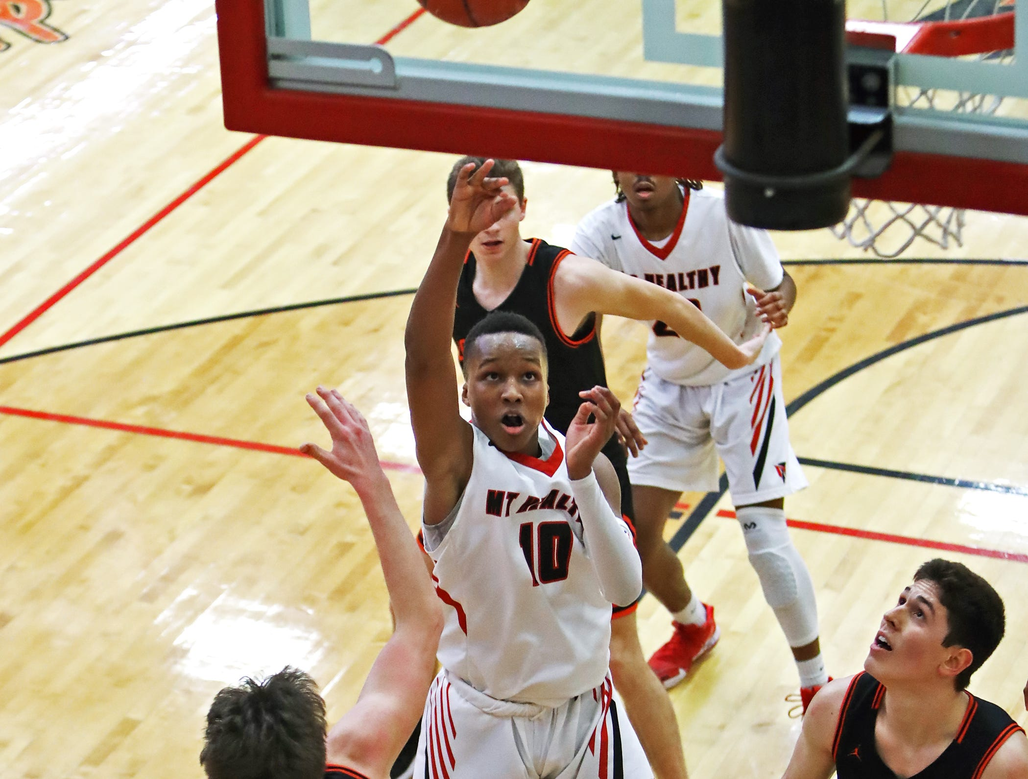 Mount Healthy guard Kollin Tolbert scores on this jump shot in the sectional playoffs at Lakota West High School Feb. 23, 2019. Mount Healthy defeated Loveland 62-57.