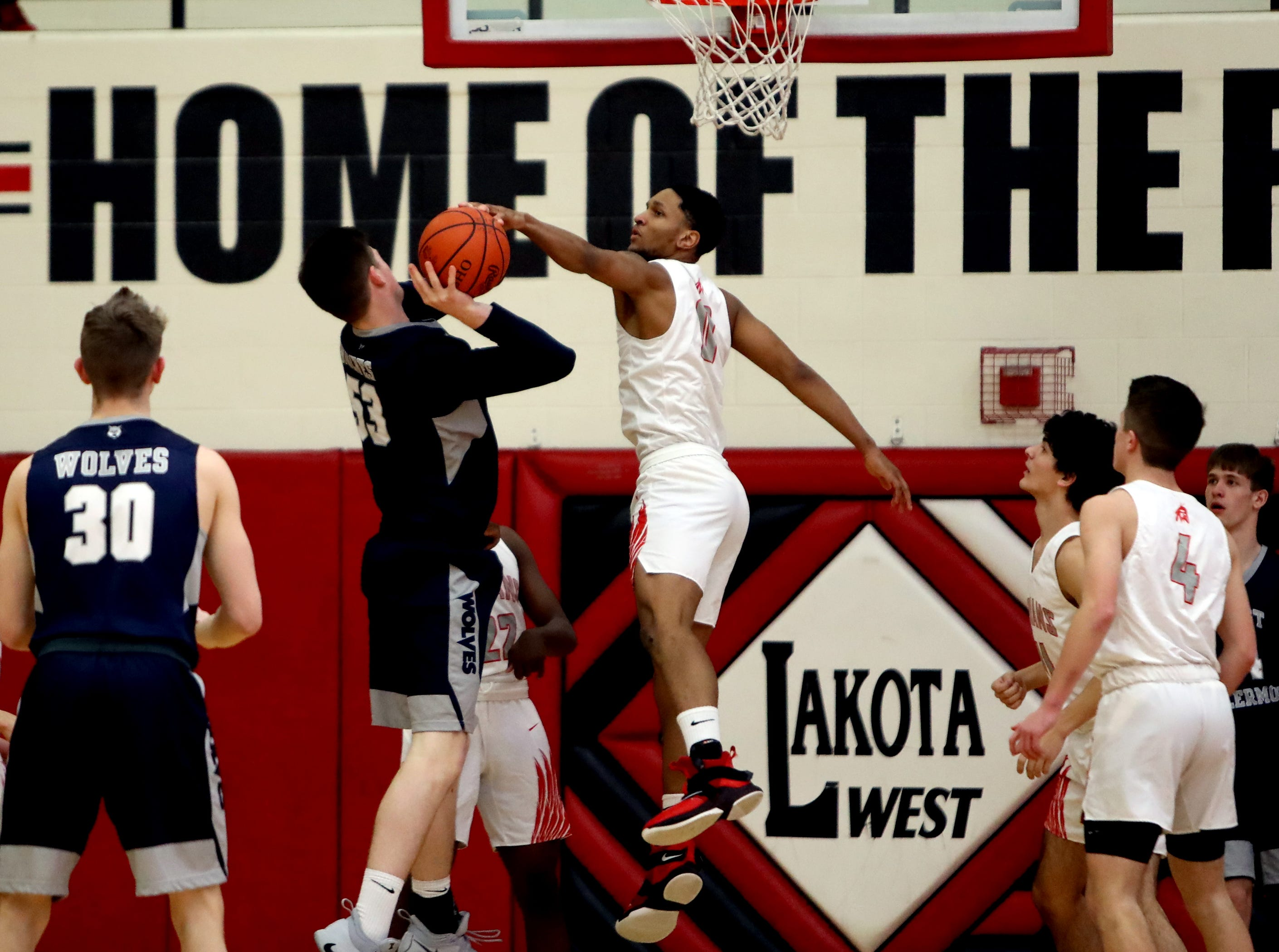 Fairfield guard Devin Turner blocks the shot of West Clermont center Jackson Ames.
