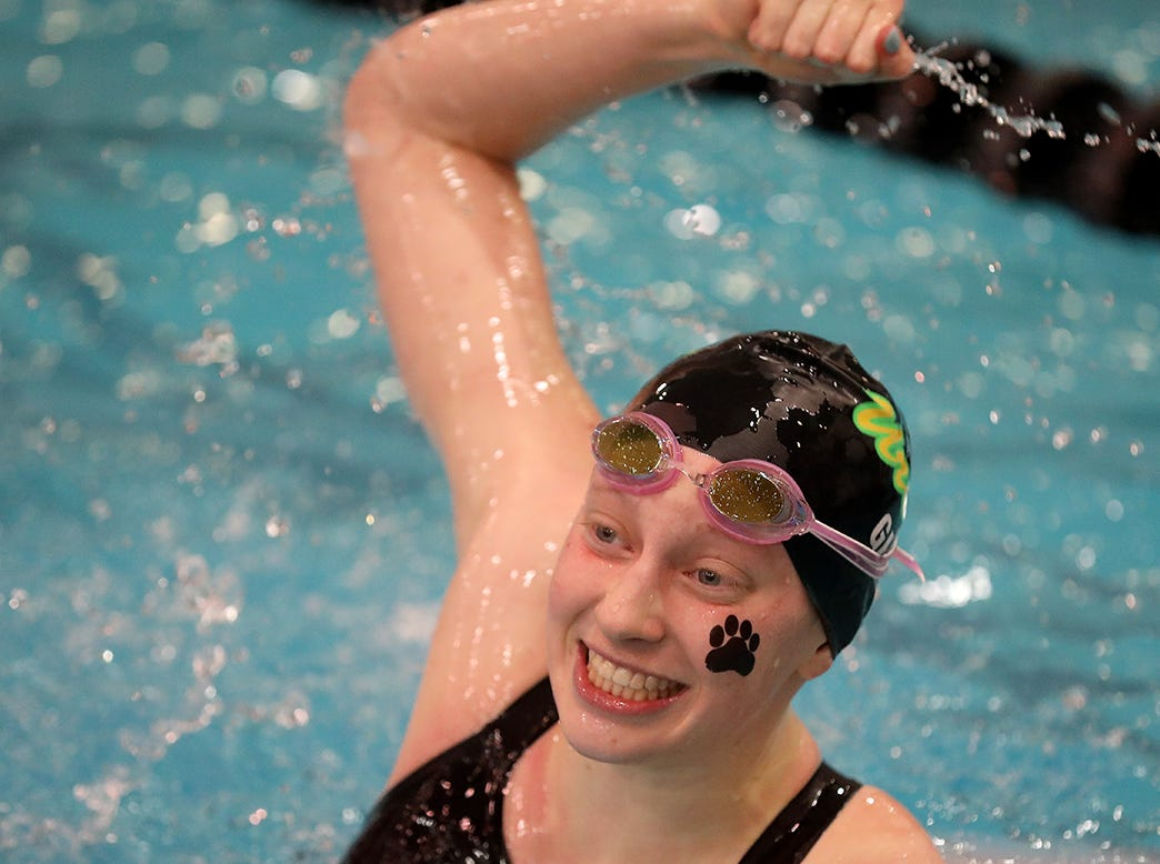 Ursuline swimmer Megan Glass reacts after winning the girls 100 fly at the OHSAA state swimming and diving championships in Canton, Ohio, Friday, Feb. 23, 2019.